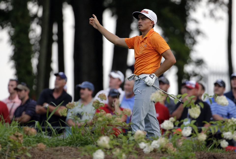 Photo - Rickie Fowler watches his tee shot on the 14th hole during the final round of the PGA Championship golf tournament at Valhalla Golf Club on Sunday, Aug. 10, 2014, in Louisville, Ky. (AP Photo/Jeff Roberson)