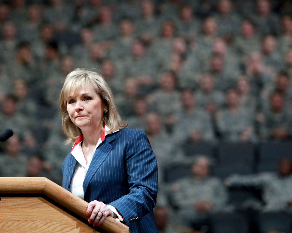 Photo - Oklahoma Governor Mary Fallin speaks during a deployment ceremony for members of the 45th Infantry Brigade Combat Team at The OKC Arena in Oklahoma City on Wednesday, Feb. 16, 2011. Photo by John Clanton, The Oklahoman