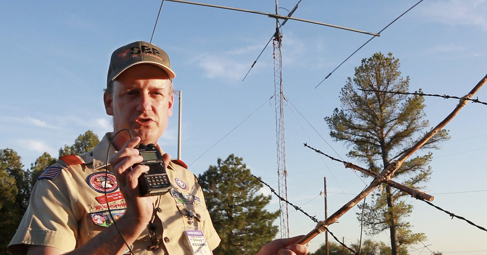 Photo - BOY SCOUTS: Doug Cook, with the Radio Scouter Group, holds a barb wire antenna and a 5-watt radio he used to contact the International Space Station  during the 54th Jamboree-On-The -Air at  John Nichols Scout Ranch, Saturday, October 15, 2011.   Photo by David McDaniel, The Oklahoman  ORG XMIT: KOD