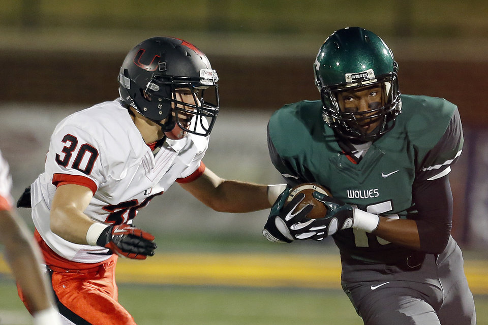 Edmond Santa Fe\'s Calvin Harkless II rushes during the high school football game between Edmond Santa Fe and Union at Wantland Stadium in Edmond, Okla., Friday, Nov. 16, 2012. Photo by Sarah Phipps, The Oklahoman