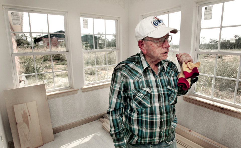Bob Mashore stands in his new Lone Grove home recently. The house he and his wife, Cherrille, shared for 30 years, which stands only a few yards away, was heavily damaged by the Feb. 10 tornado. PHOTO BY STEVE SISNEY, THE OKLAHOMAN