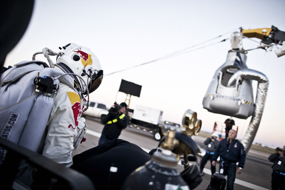 Photo -   In this photo provided by Red Bull, Pilot Felix Baumgartner of Austria steps out from his trailer during the final manned flight for Red Bull Stratos in Roswell, N.M. on Saturday, Oct. 14, 2012. Baumgartner plans to jump from an altitude of 120,000 feet, an altitude chosen to enable him to achieve Mach 1 in free fall, which would deliver scientific data to the aerospace community about human survival from high altitudes.(AP Photo/Red Bull Stratos, Balazs Gardi) MANDATORY CREDIT