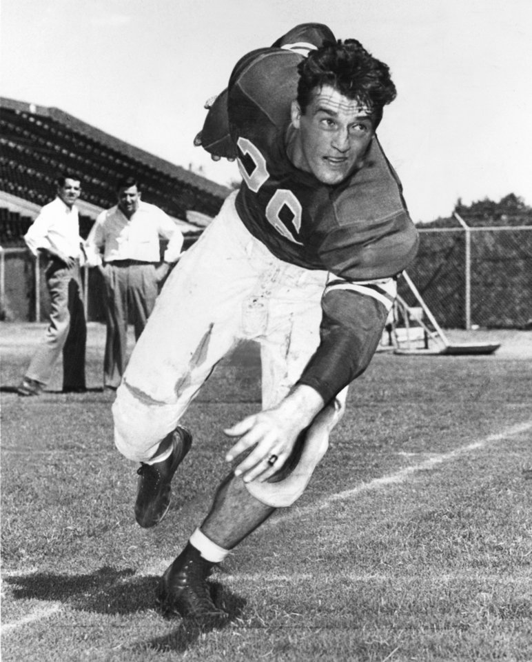 Jack Mitchell, Oklahoma\'s ground-gobbling quarterback, slips the ball on his hip for a practice spin in 1946. OKLAHOMAN ARCHIVE PHOTO