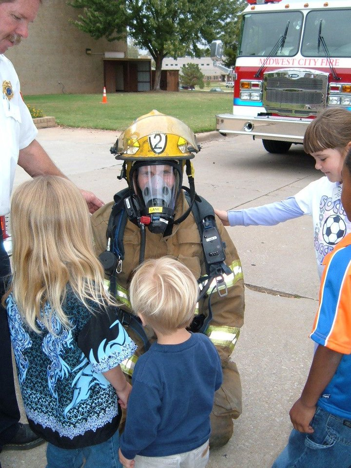 Children touch a firefighter when dressed in protective clothing<br/><b>Community Photo By:</b> Jerry Lojka, PIO<br/><b>Submitted By:</b> Jerry,