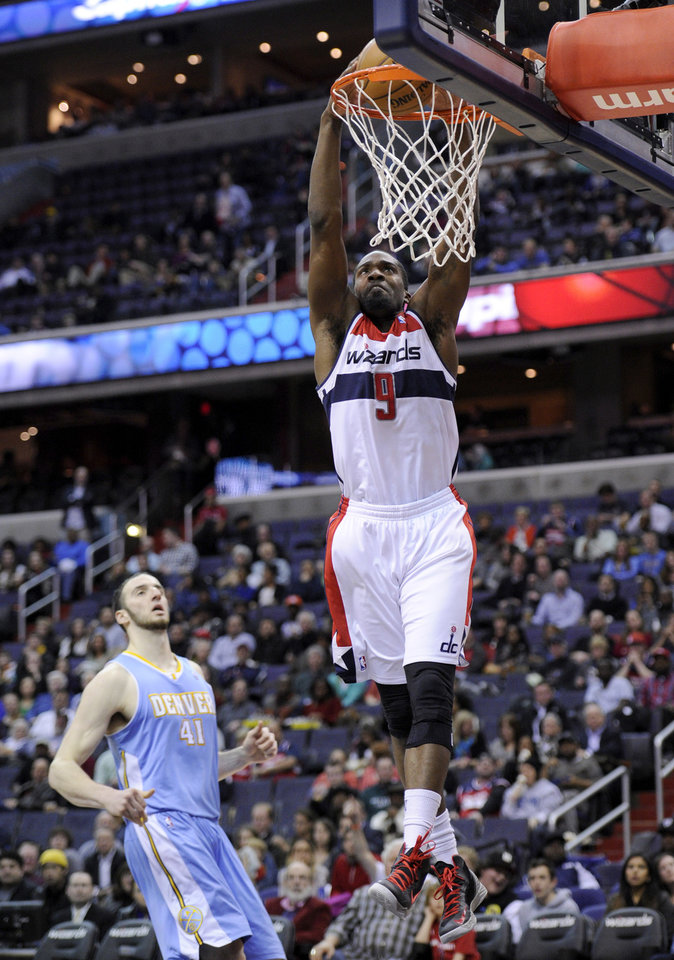 Washington Wizards forward Martell Webster (9) dunks against Denver Nuggets center Kosta Koufos (41) during the second half of an NBA basketball game, Friday, Feb. 22, 2013, in Washington. The Wizards won 119-113. (AP Photo/Nick Wass)