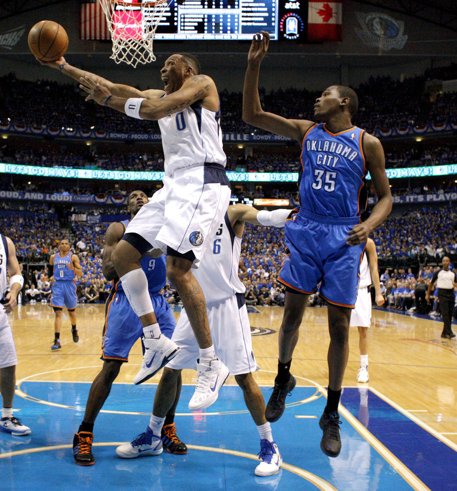 Photo - Shawn Marion (0) of Dallas goes past Oklahoma City's Kevin Durant (35)during game 5 of the Western Conference Finals in the NBA basketball playoffs between the Dallas Mavericks and the Oklahoma City Thunder at American Airlines Center in Dallas, Wednesday, May 25, 2011. Photo by Bryan Terry, The Oklahoman
