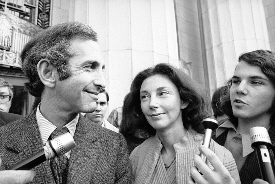 In this Wednesday, April 12, 1973 photo, Daniel Ellsberg, co-defendant in the Pentagon Papers trial, talks with newsmen after he testified in Los Angeles. Next to him is his wife, Patricia. Ellsberg, who vividly described his journey to disillusionment in Vietnam on Wednesday, will climax that story on Thursday, telling jurors how he risked his government career to copy the Pentagon Papers, hoping to end the war. As the last U.S. combat troops left Vietnam 40 years ago, angry protesters still awaited them at home. North Vietnamese soldiers took heart from their foes' departure, and South Vietnamese who had helped the Americans feared for the future. While the fall of Saigon two years later � with its indelible images of frantic helicopter evacuations � is remembered as the final day of the Vietnam War, Friday marks an anniversary that holds greater meaning for many who fought, protested or otherwise lived it.  (AP Photo)