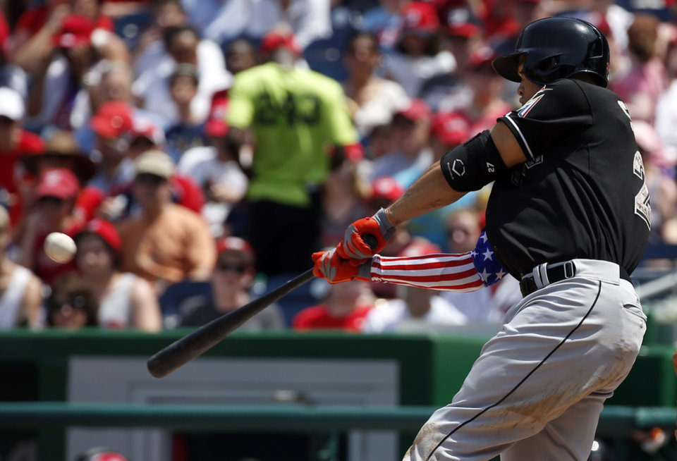 Photo - Miami Marlins' Giancarlo Stanton hits a two-run homer during the third inning of a baseball game against the Washington Nationals at Nationals Park Monday, May 26, 2014, in Washington. (AP Photo/Alex Brandon)