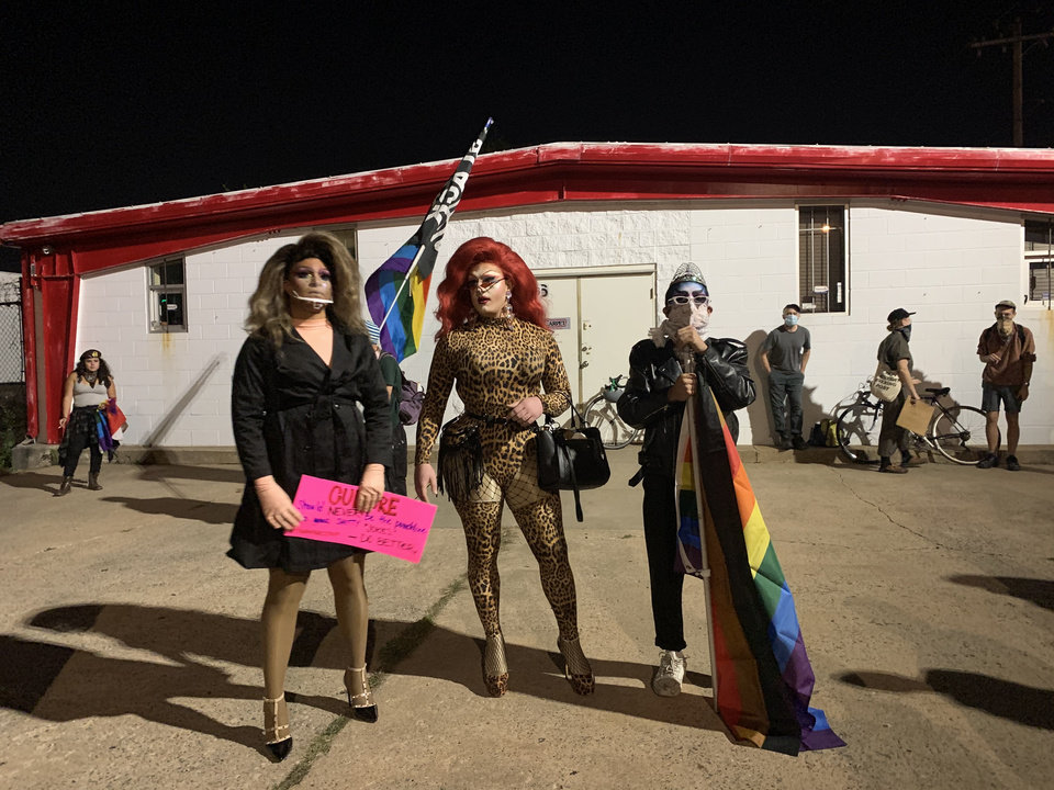 Photo - Drag performers Shalula Queen, left, Lana Love, center, and Topatío are seen at a Friday protest along 39th Street in Oklahoma City. [Siali Siaosi/The Oklahoman]