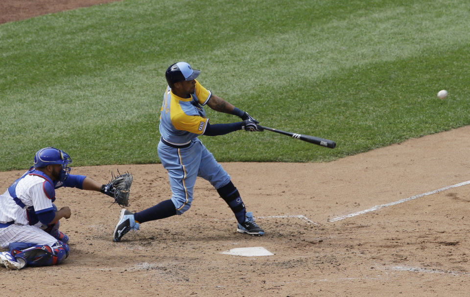 Photo - Tampa Bay Rays' Desmond Jennings hits an one-run double against the Chicago Cubs during the seventh inning of an interleague baseball game in Chicago, Sunday, Aug. 10, 2014. (AP Photo/Nam Y. Huh)