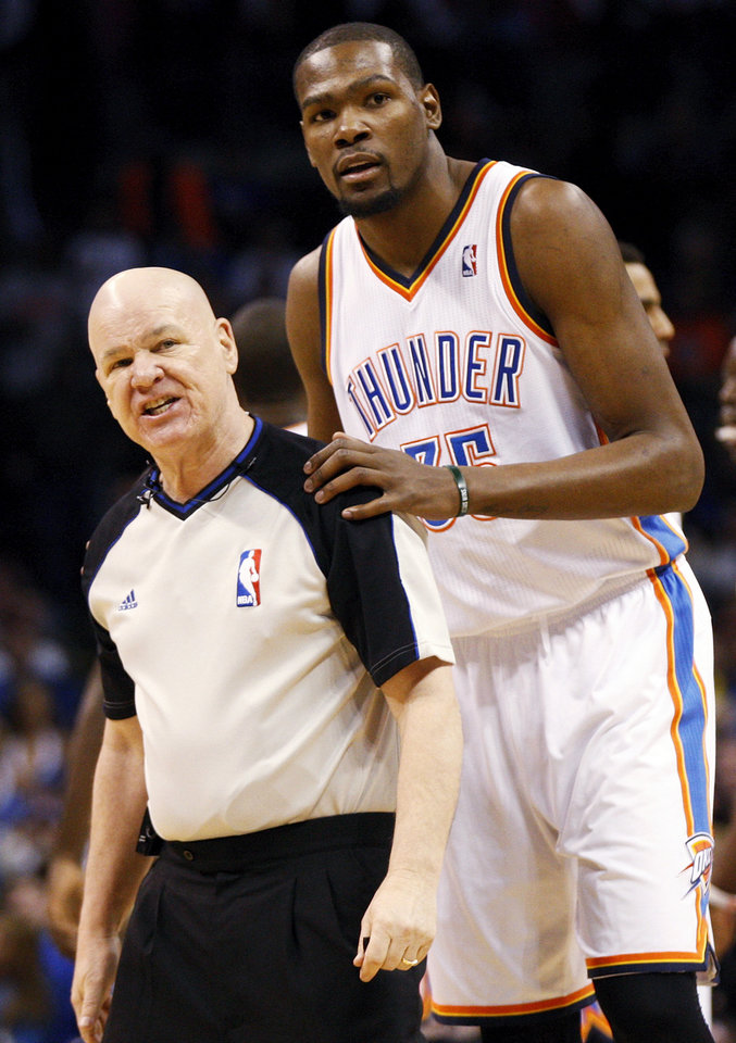 Photo - Oklahoma City's Kevin Durant (35) talks with official Joe Crawford during an NBA basketball game between the New York Knicks and the Oklahoma City Thunder at Chesapeake Energy Arena in Oklahoma City, Sunday, Feb. 9, 2014. Photo by Nate Billings, The Oklahoman