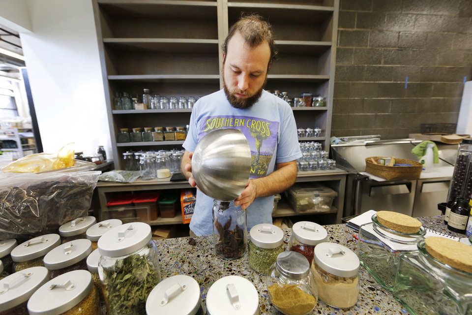 Doug Rader prepares the Spice Bar for opening day at Native Roots Market at NE 2 and Walnut in Oklahoma City. Photo by Steve Gooch, The Oklahoman <strong>Steve Gooch - The Oklahoman</strong>