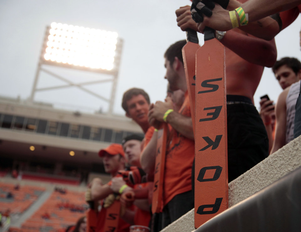 Photo - Fans hold paddles before a college football game between Oklahoma State University (OSU) and the University of Texas (UT) at Boone Pickens Stadium in Stillwater, Okla., Saturday, Sept. 29, 2012. Photo by Sarah Phipps, The Oklahoman