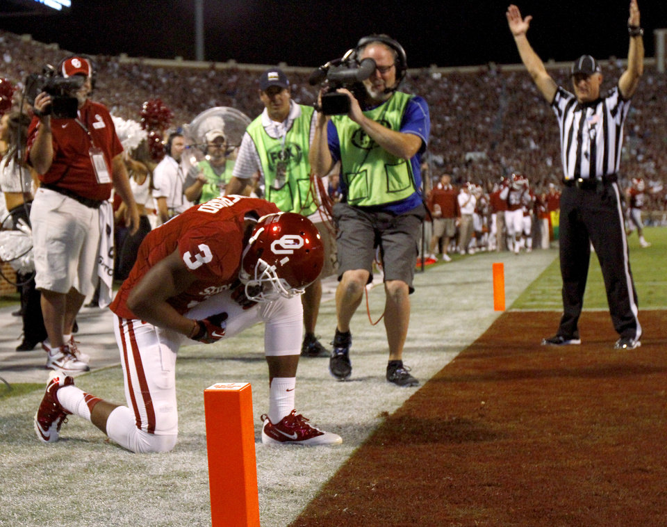 Photo - OU's Sterling Shepard (3) kneels down after scoring a touchdown during the college football game between the University of Oklahoma Sooners (OU) and the Kansas Jayhawks (KU) at Gaylord Family-Oklahoma Memorial Stadium in Norman, Okla., Saturday, Oct. 20, 2012. Photo by Bryan Terry, The Oklahoman