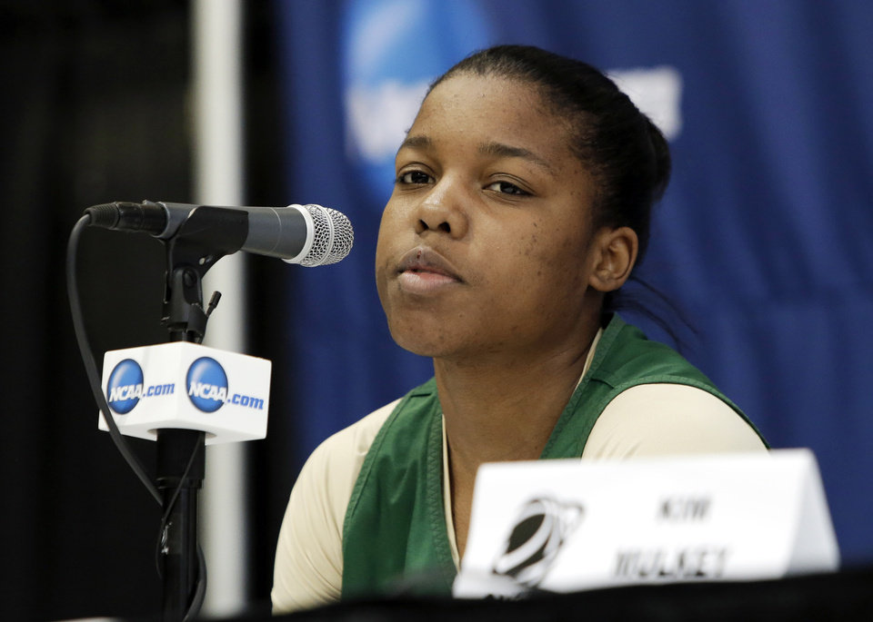 Photo - Baylor guard Niya Johnson responds to a question during an NCAA college basketball tournament news conference, Sunday, March 23, 2014, in Waco, Texas. Baylor is scheduled to play California on Monday. (AP Photo/Tony Gutierrez)