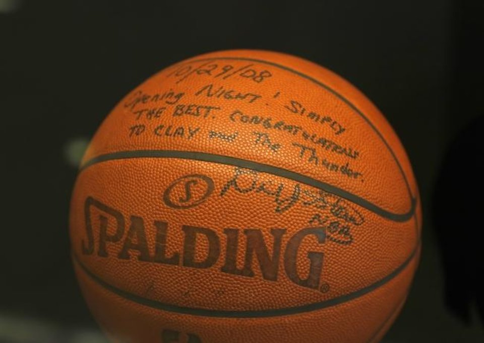 Photo -  A game ball from the Thunder's first regular-season game inscribed and signed by NBA commissioner David Stern and given to Clay Bennett on display in Chesapeake Energy Arena. [Nate Billings/The Oklahoman]