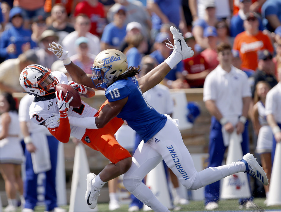Photo - Oklahoma State's Tylan Wallace (2) can not hang on to a pass as Tulsa's Manny Bunch (10) defends in the first quarter during a college football game between the Oklahoma State University Cowboys (OSU) and the University of Tulsa Golden Hurricane (TU) at H.A. Chapman Stadium in Tulsa, Okla., Saturday, Sept. 14, 2019. [Sarah Phipps/The Oklahoman]