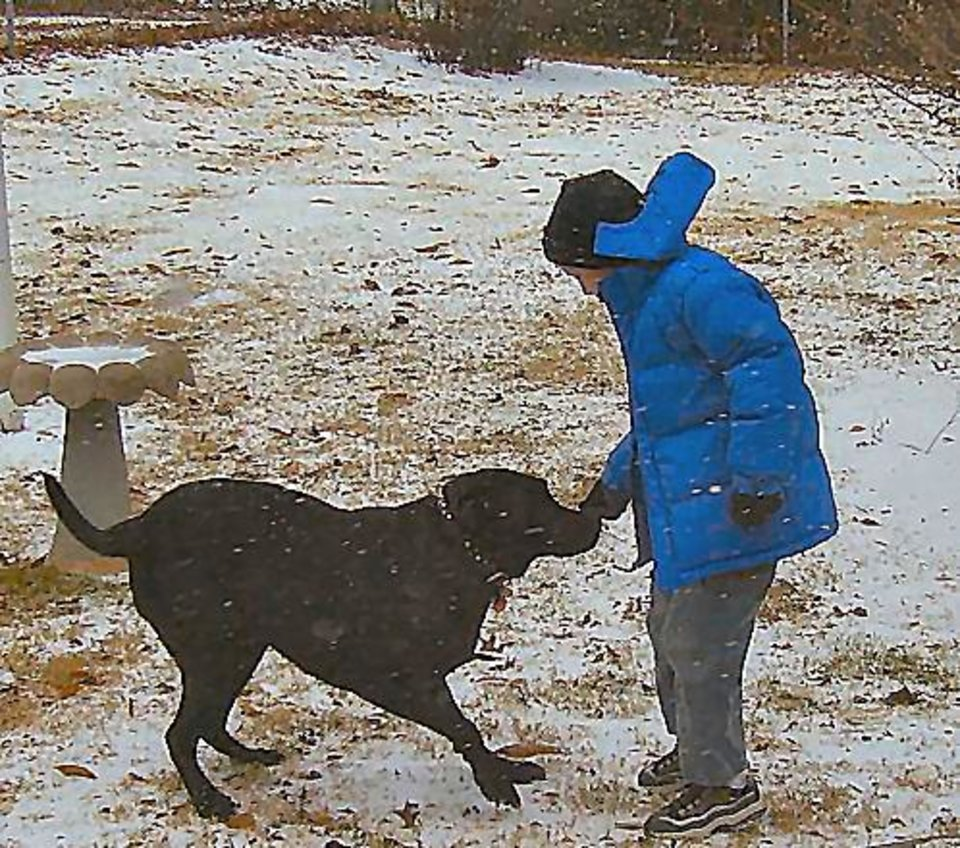 Eight year old Sam and his black lab, Dakota, as the snow just gets started.<br/><b>Community Photo By:</b> Kallin Curry<br/><b>Submitted By:</b> Kallin, Midwest City