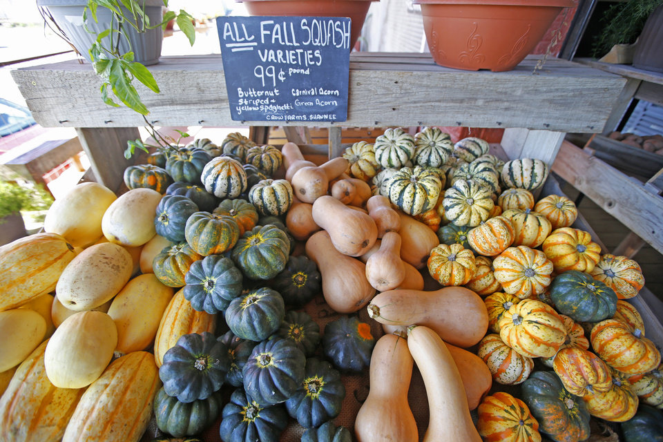 Photo -  Organic squash on display at Urban Agrarian in Oklahoma City, Friday September, 30 2016. [Photo By Steve Gooch, The Oklahoman]