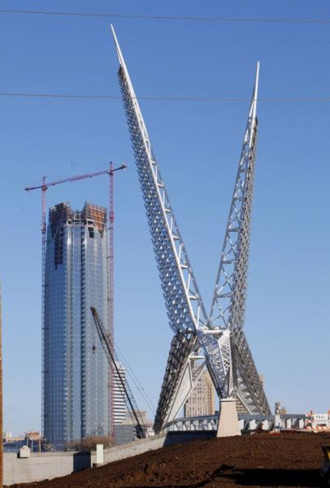 Photo - The Skydance Bridge is under construction over the new Interstate 40 just west of Robinson Avenue in Oklahoma City, while the Devon Energy tower rises in the background. Photo by Paul B. Southerland, The Oklahoman