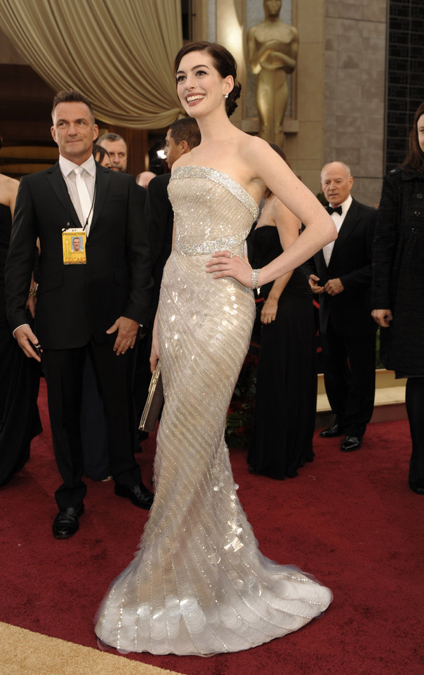 Photo - ** LINDA MILLER'S COMMENTARY:     Love the dress, but prefer more color on her.  ** Anne Hathaway, nominated for an Oscar for best actress in a leading role for her work in