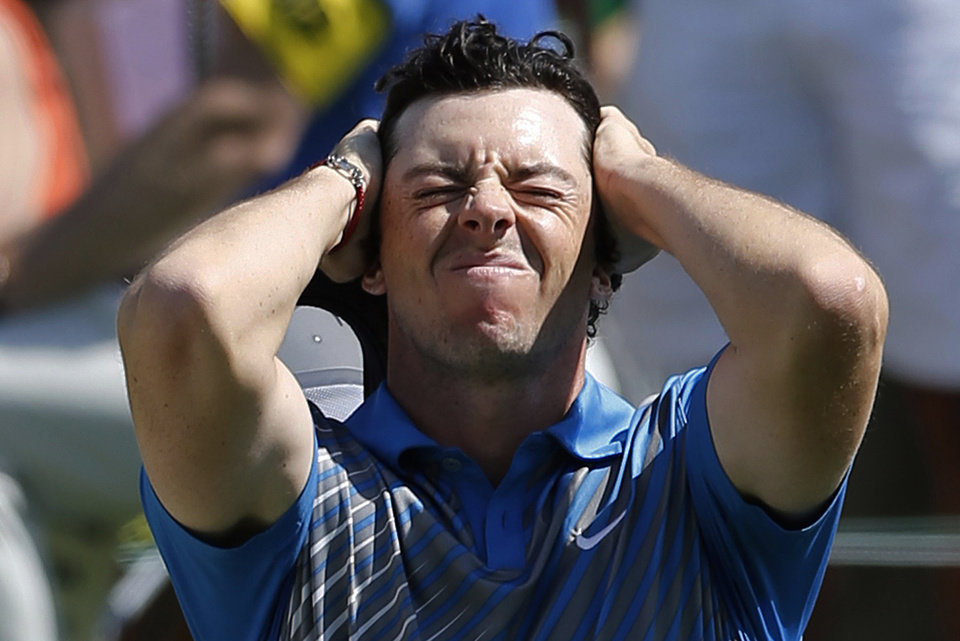 Photo - Rory McIlroy, of Northern Ireland, reacts after a bogey on the 18th hole at the Memorial golf tournament in Dublin, Ohio, Friday, May 30, 2014. (AP Photo/The Columbus Dispatch, Adam Cairns)