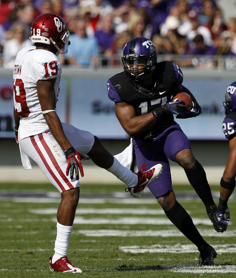 Photo - TCU's Sam Carter (17) comes down with an interception on a pass intended for Oklahoma's Justin Brown (19) in the first half of an NCAA college football game Saturday, Dec. 1, 2012, in Fort Worth, Texas. (AP Photo/Tony Gutierrez)