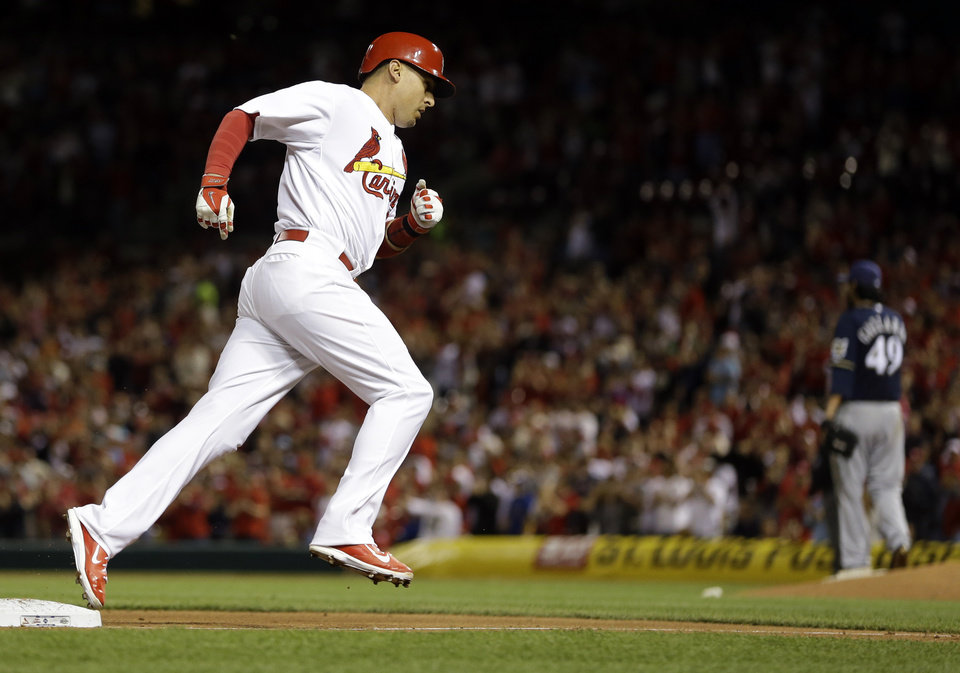 Photo - St. Louis Cardinals' Allen Craig rounds the bases after hitting a solo home run off Milwaukee Brewers starting pitcher Yovani Gallardo during the sixth inning of a baseball game Monday, April 28, 2014, in St. Louis. (AP Photo/Jeff Roberson)