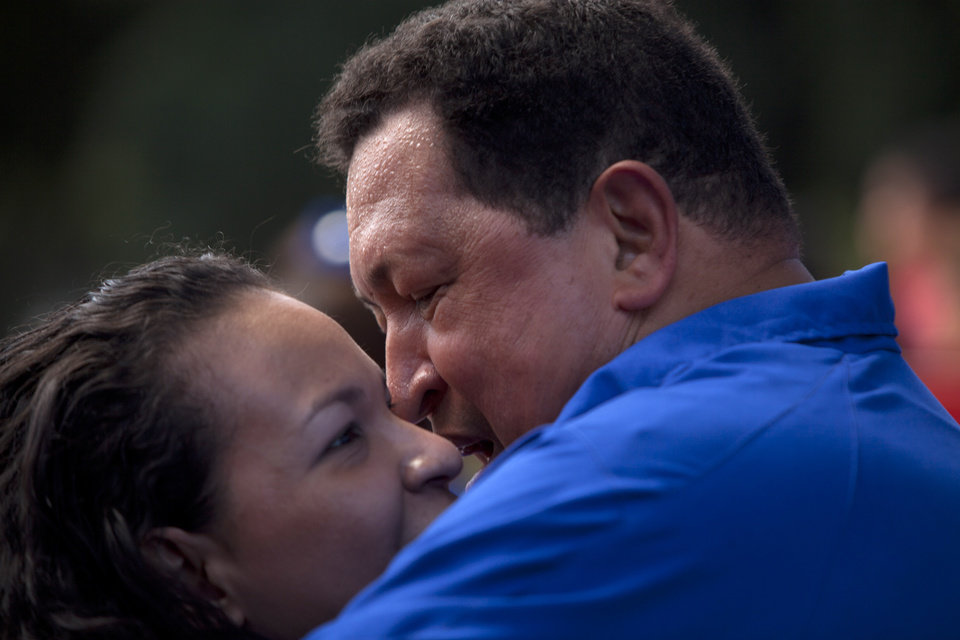Venezuela's President Hugo Chavez, right, kisses his daughter Rosa Virginia during a campaign rally in Maracay, Venezuela, Wednesday, Oct. 3, 2012. Chavez is running for re-election against opposition candidate Henrique Capriles in presidential elections on Oct . 7. (AP Photo/Nicolas Garcia)