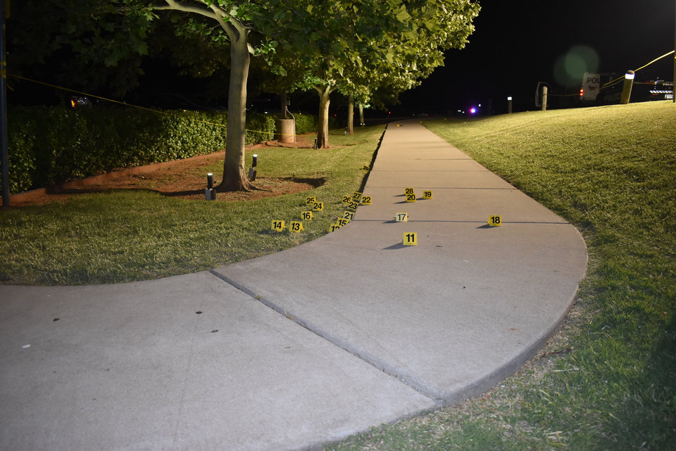 Photo - Oklahoma City police marked where shell casings were found outside Louie's Grill & Bar at Lake Hefner in Oklahoma City. The majority were in this spot where the gunman on May 24 fired at the door of the restaurant and an armed civilian later fired at the gunman. [Photo provided]