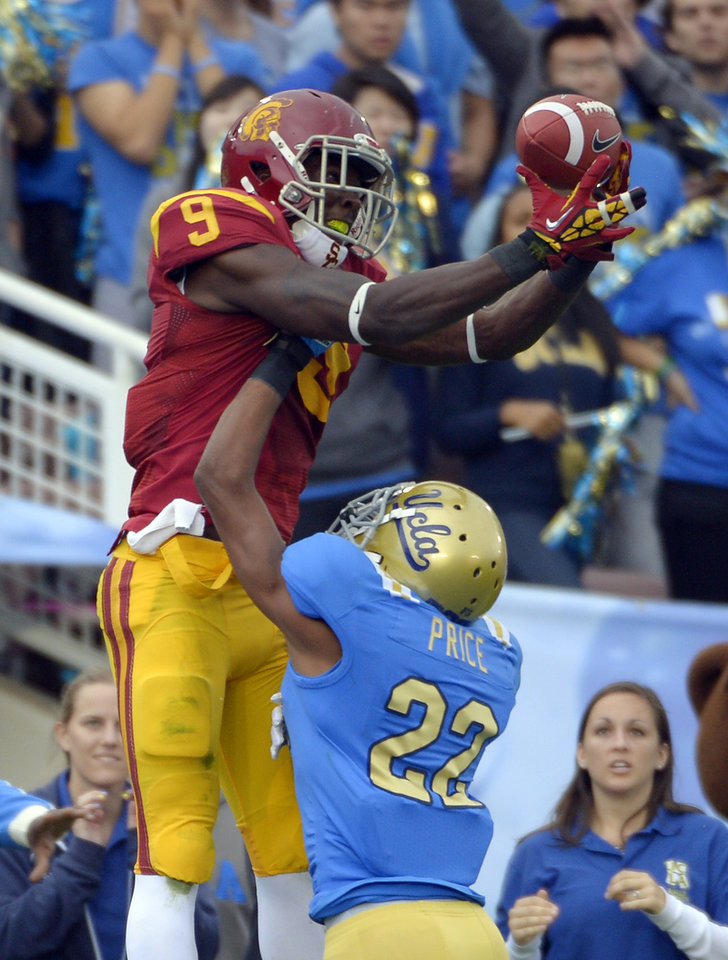 Southern California wide receiver Marqise Lee, left, can\'t hold on to a pass in the end zone as UCLA cornerback Sheldon Price defends during the first half of their NCAA college football game, Saturday, Nov. 17, 2012, in Pasadena, Calif. Price was called for pass interference on the play. (AP Photo/Mark J. Terrill)