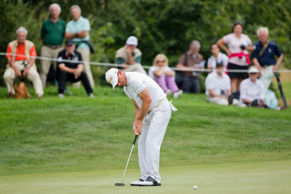 Photo - Germany's Alex Cejka  putts the ball during the  BMW International Open golf tournament  in Pulheim near Cologne, Germany,  Friday June 27, 2014.  (AP Photo/dpa,Rolf Vennenbernd)