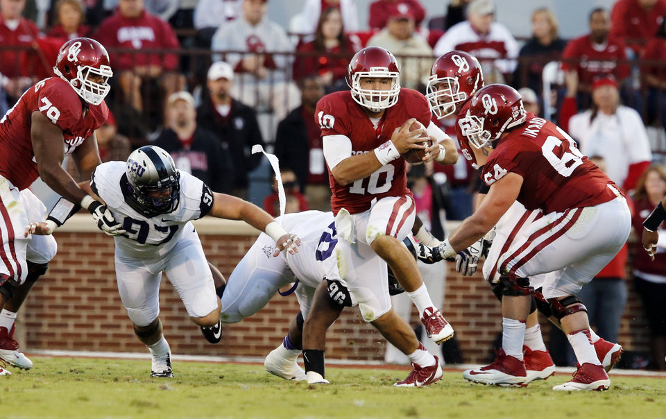 Photo - Oklahoma's Blake Bell (10) carries during a college football game between the University of Oklahoma Sooners (OU) and the TCU Horned Frogs at Gaylord Family-Oklahoma Memorial Stadium in Norman, Okla., on Saturday, Oct. 5, 2013. Photo by Steve Sisney, The Oklahoman