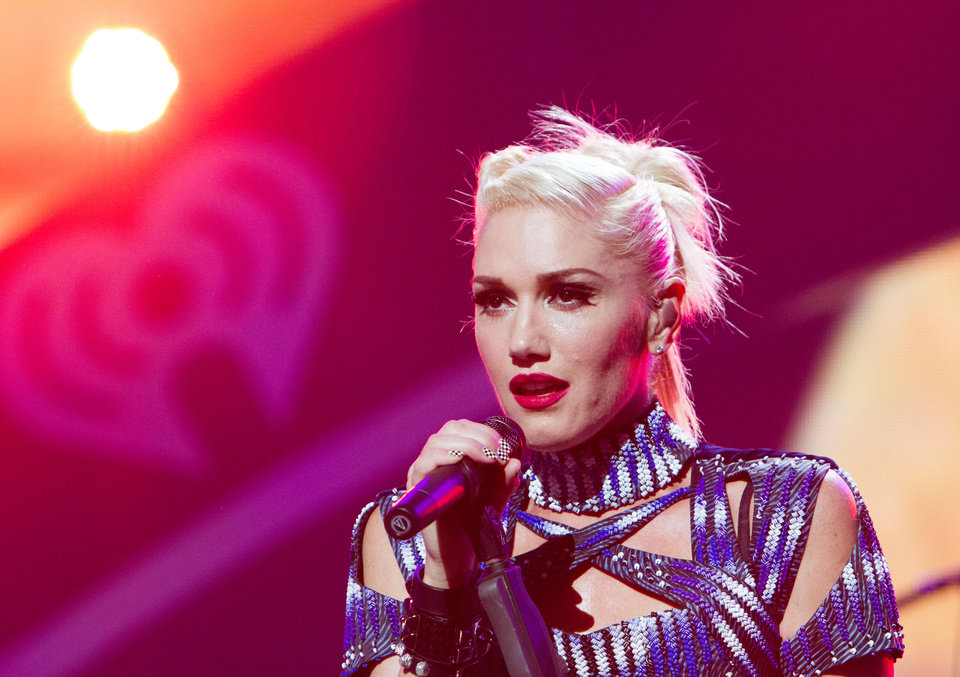 "FILE - This Sept. 21, 2012 file photo originally released by Clear Channel shows Gwen Stefani of No Doubt performing at the 2012 iHeartRadio Music Festival at the MGM Grand Garden Arena in Las Vegas, Nev. No Doubt has pulled its new cowboys and Indians-themed music video and is apologizing to Native Americans and others who were offended by the clip. The band posted on its website Saturday, Nov. 3, that the video for ""Looking Hot"" was ""never to offend, hurt or trivialize Native American people."" The video features Gwen Stefani and bandmate Tony Kanal dressed in traditional Native American clothes, while Adrian Young and Tom Dumont are in cowboy get-ups with guns. Stefani also rides and horse and sings in a tepee in the clip, which includes a fire-burning dance scene with others dressed in Native American clothes. (AP Photo/Clear Channel, Andrew Swartz)"