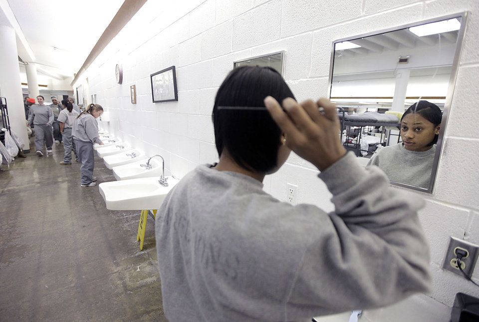 Tenisha Little does her hair at Eddie Warrior Correctional Center Dec. 1, 2010. MIKE SIMONS/Tulsa World
