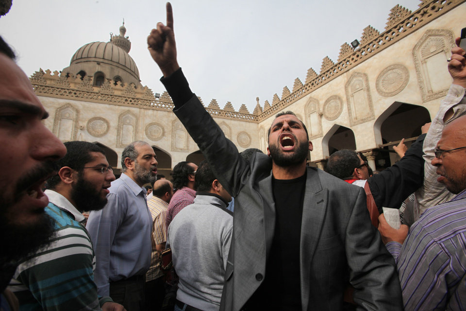 Protesters chant slogans against the Israeli invasion of Gaza, in Al-Azhar mosque, where President Mohammed Morsi's Muslim Brotherhood called for demonstrations, after Friday prayers, in Cairo, Egypt, Friday, Nov. 16, 2012. In his Friday sermon at Al-Azhar, influential cleric Sheikh Yusuf al-Qaradawi, not shown, said the Islamic world would not be silent in the face of Israel's military operation in Gaza. (AP Photo/Thomas Hartwell) ORG XMIT: CAI106