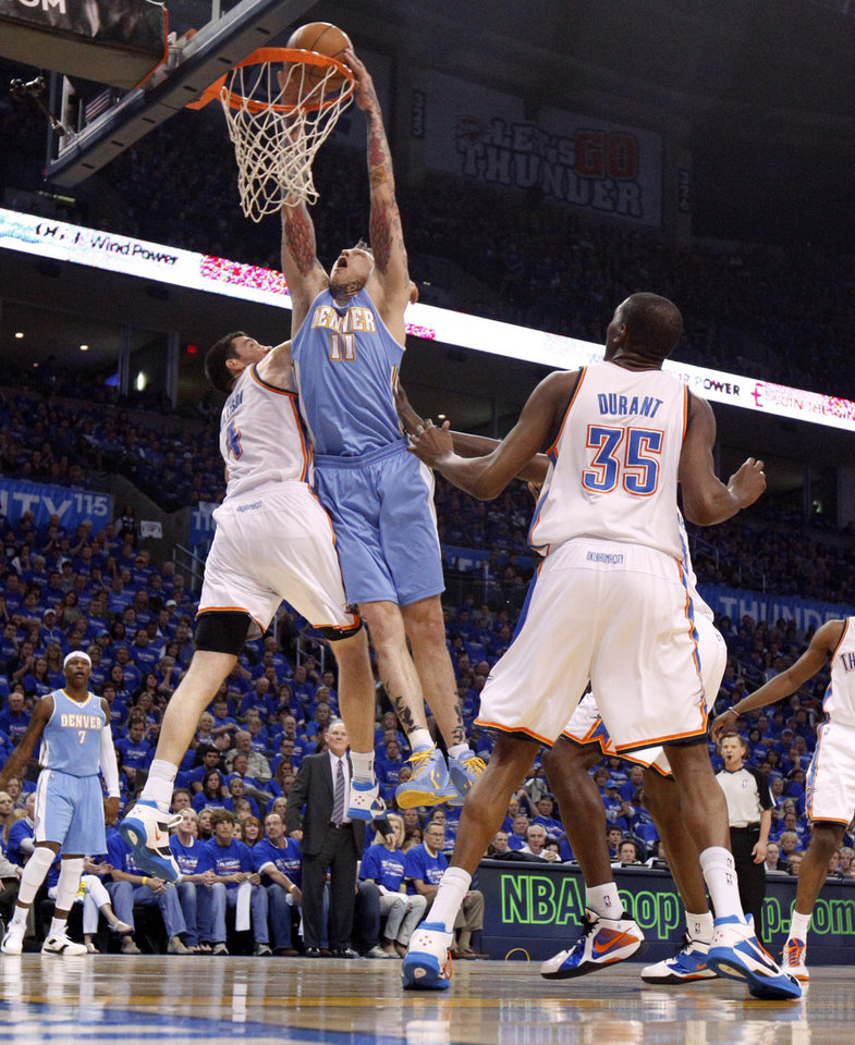 Denver\'s Chris Andersen (11) dunks the ball between Oklahoma City\'s Nick Collison (4) and Kevin Durant (35) during the NBA basketball game between the Denver Nuggets and the Oklahoma City Thunder in the first round of the NBA playoffs at the Oklahoma City Arena, Sunday, April 17, 2011. Photo by Bryan Terry, The Oklahoman