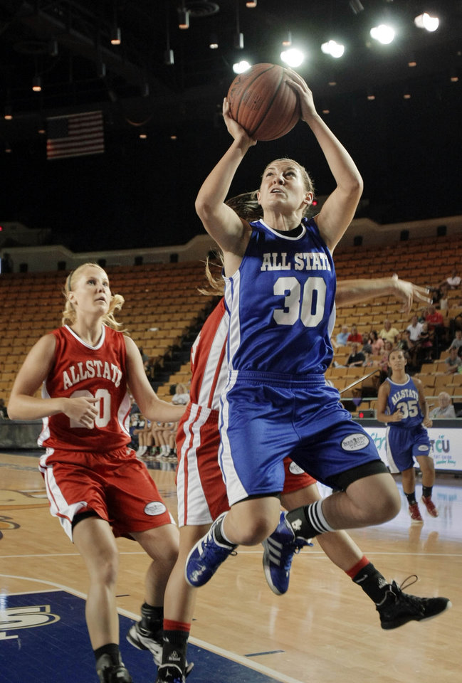 Photo - The West's Lacey Paulk looks on a the East's Kelsey Barnwell puts up a shot during the All State Small School Girls Basketball game at Oral Roberts University in Tulsa, OK, July 25, 2012. MICHAEL WYKE/Tulsa World