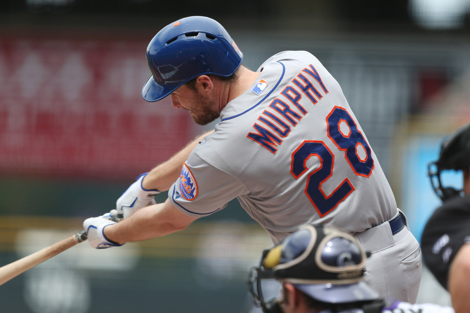 Photo - New York Mets' Daniel Murphy connects for a single against the Colorado Rockies in the first inning of a baseball game in Denver, Sunday, May 4, 2014. (AP Photo/David Zalubowski)
