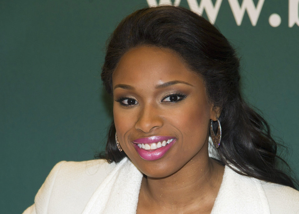 Photo -   FILE - In this Jan. 10, 2012 file photo, singer and actress Jennifer Hudson attends a book signing in New York. A Chicago jury has convicted Hudson's former brother-in-law of murdering her mother, brother and 7-year-old nephew in what prosecutors described as an act of vengeance by a jilted husband. The jury convicted 31-year-old William Balfour on three-counts of first degree murder on Friday, May 11, 2012, after three days of deliberations. He faces a mandatory sentence of life in prison. (AP Photo/Charles Sykes, File)