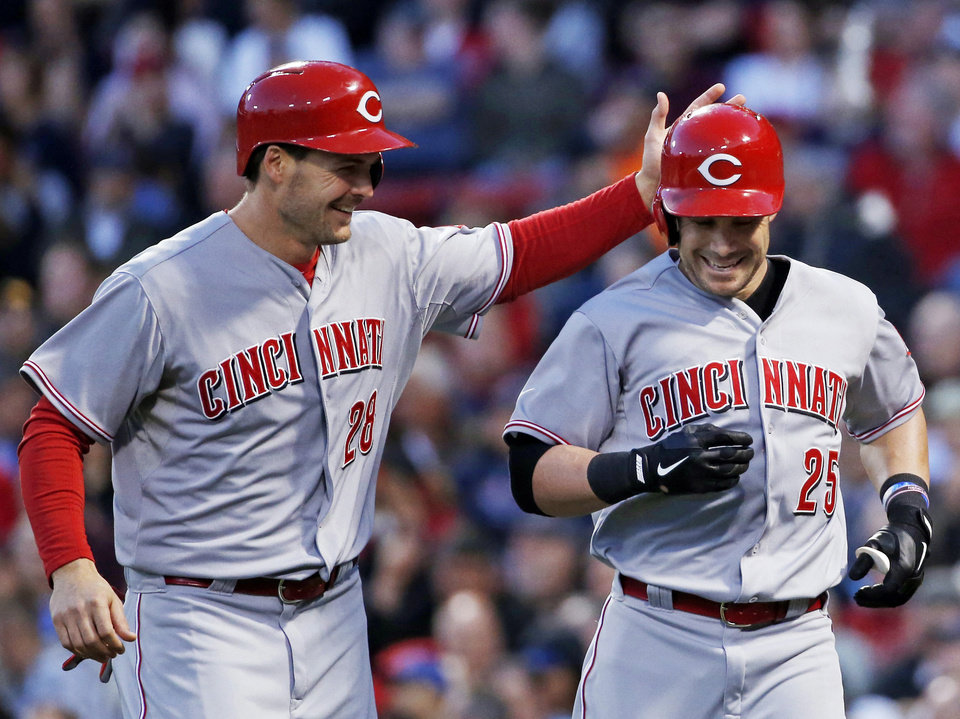 Photo - Cincinnati Reds' Skip Schumaker (25) is congratulated by Chris Heisey (28) after his two-run homer against the Boston Red Sox during the third inning of a baseball game at Fenway Park in Boston, Wednesday, May 7, 2014. (AP Photo/Elise Amendola)