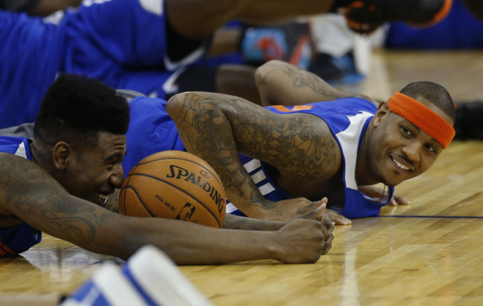 New York Knicks forward Carmelo Anthony, right, and guard Iman Shumpert, left, who had offseason surgery to correct a torn left ACL, take part in a training session at the 02 arena in London, Wednesday, Jan. 16, 2013. The Detroit Pistons are due to play a