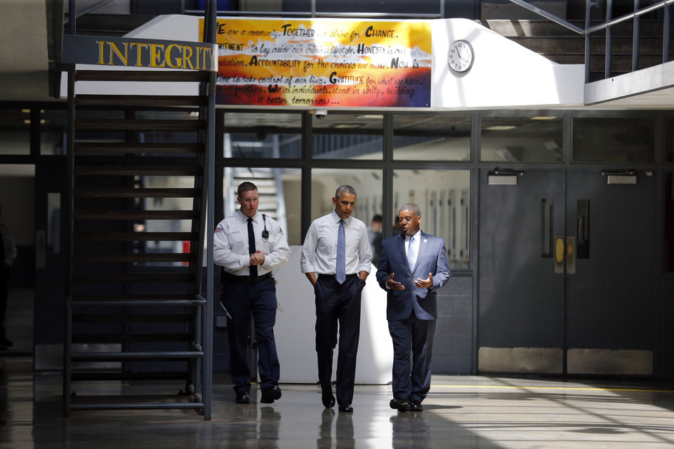Photo - President Barack Obama tours the El Reno Federal Correctional Institution with Charles Samuels, Bureau of Prisons Director and Ronald Warlick, Correctional Officer, left, in El Reno, Okla., Thursday, July 16, 2015. Photo by Sarah Phipps, The Oklahoman