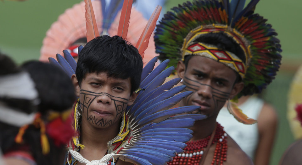 Photo - Brazilian Indians watch Germany's national soccer team at a training session near Porto Seguro, Brazil, Monday, June 9, 2014. Germany will play in group G of Brazil's 2014 soccer World Cup. (AP Photo/Matthias Schrader)