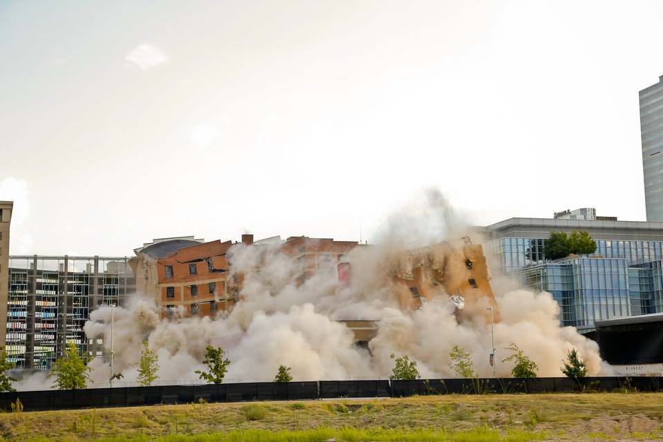Photo - Frame 7 of a ten frame photo sequence of the Hotel Black and the adjoining parking garage in downtown Oklahoma City being taken down during an implosion by Midwest Wrecking Company on Sunday, Sept. 13, 2015, in Oklahoma City, Okla.  Photo by Chris Landsberger, The Oklahoman