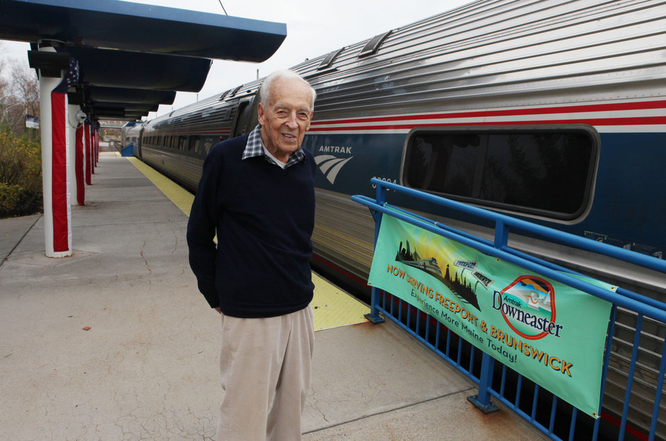 Photo -   Nelson Soule, 91, poses next to the Amtrak Downeaster train Wednesday, Oct. 31, 2012 at the station in Portland, Maine. Soule will be aboard Amtrak's Downeaster on Thursday as the Boston-to-Portland service expands northward to Freeport and Brunswick for the first time in more than 50 years. (AP Photo/Joel Page)