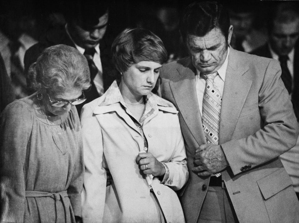 Family members mourn before the casket of Lt. Pat Grimes on May 29, 1978. The body of Grime and those of two other Oklahoma Highway Patrol troopers killed Friday in a gun battle with two Oklahoma State Penitentiary fugitives laid in the Capitol Rotunda as peace officers and friend paid tribute.  Photo by J. Don Cook, The Oklahoman.Copy of a print from The Oklahoman Archive, Tuesday, Dec. 6, 2011.