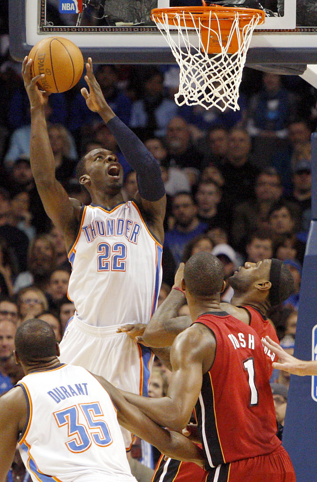 Photo - Oklahoma City's Jeff Green puts up a shot in front of Miami's Chris Bosh and LeBron James during their NBA basketball game at the OKC Arena in Oklahoma City on Thursday, Jan. 30, 2011. Photo by John Clanton, The Oklahoman