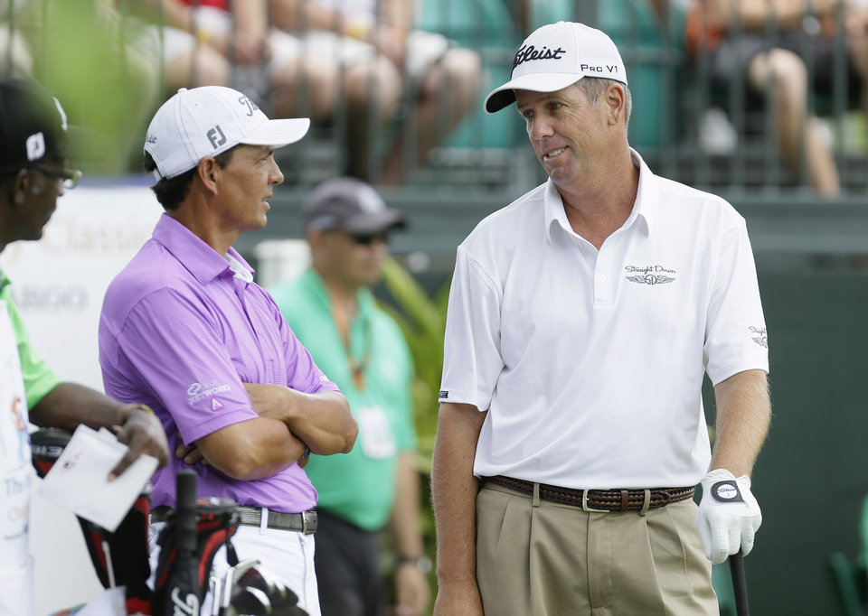 Photo - Tom Pernice Jr., left, talks with Doug Garwood before hitting on the first tee during the final round of the Champions Tour's Principal Charity Classic golf tournament, Sunday, June 1, 2014, in Des Moines, Iowa. (AP Photo/Charlie Neibergall)