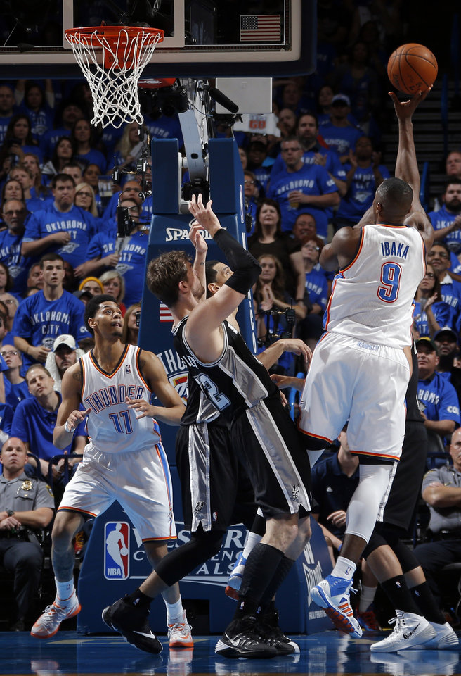 Photo - Oklahoma City's Serge Ibaka (9) shoots over San Antonio's Tiago Splitter (22) during Game 3 of the Western Conference Finals in the NBA playoffs between the Oklahoma City Thunder and the San Antonio Spurs at Chesapeake Energy Arena in Oklahoma City, Sunday, May 25, 2014. Photo by Bryan Terry, The Oklahoman